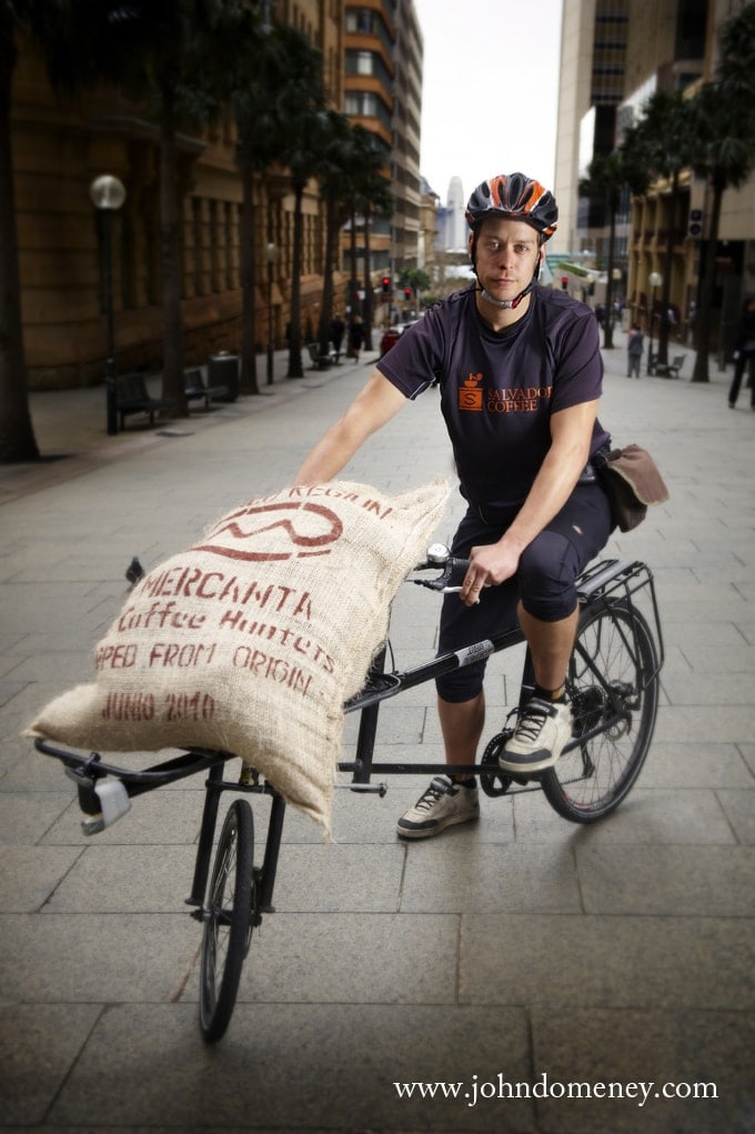 Cycle messenger delivering coffee